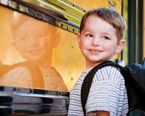 Kindergarten boy waiting for bus